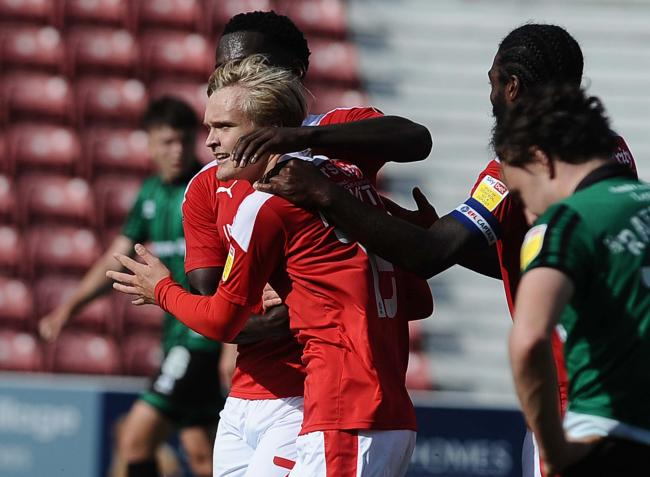 Matt Smith celebrates scoring on the opening day of the season against Rochdale Picture: Dave Evans