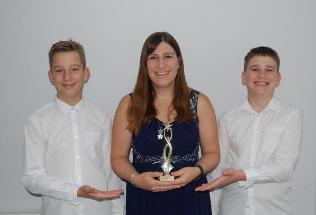 Lisa Berry, with sons Ollie and Jake, won an Excellence in Customer Care Award from the Single Mums in Business Network