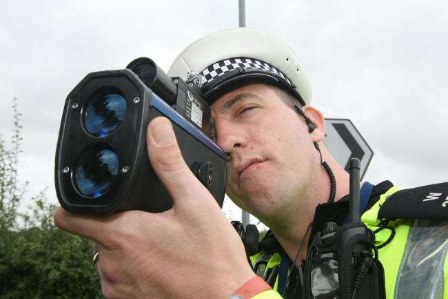 A Wiltshire Police officer carries out speed checks