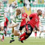 Swindon Advertiser: BHOYED UP: Junior Hoilett shows his strength to see off Celtic's Milan Misun at Parkhead