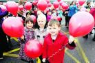 Isabelle Barrett, Oscar Wood, Kian McNally and friends get ready to release their balloons