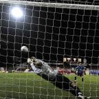 Phil Smith saves a penalty but Town lost the shoot-out