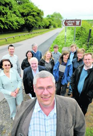 Coun Peter Greenhalgh, front, with fellow councillors and residents, who are delighted the plan for houses near Lydiard Park has been rejected by a Government inspector