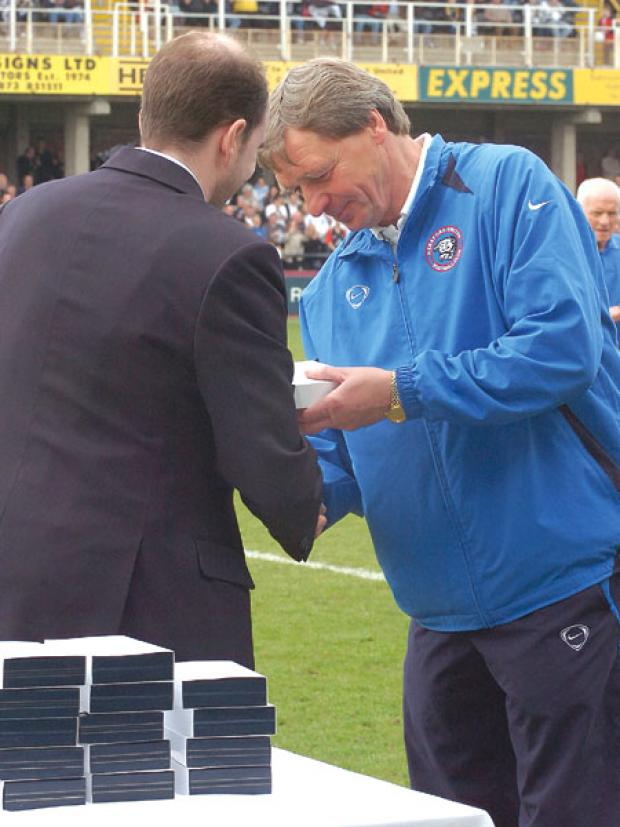 Graham Turner receives his promotion medal.