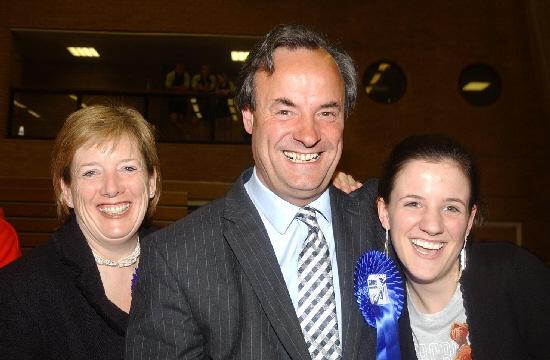 James Gray celebrates winning a third term with wife Sarah and daughter Olivia in May last year