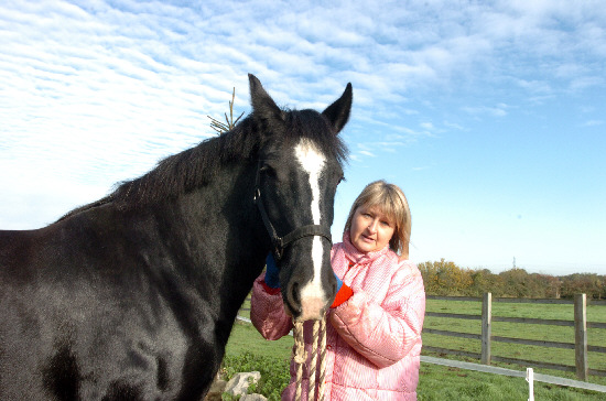 Debbie Coffey with her horse Dolly which she says was upset when a hunt passed through the field Picture Ref: 204444-45