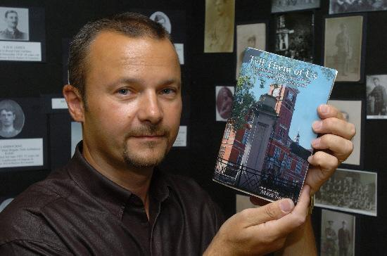 Swindon Advertiser: Mark Sutton with his book