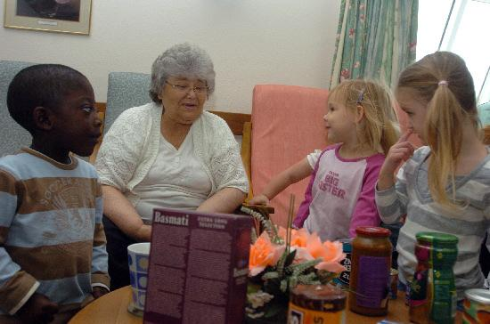 Bright Start Day Nursery pupils presenting gifts to pensioners