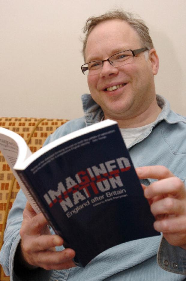 Andy Newman with the book in which he has written a chapter
