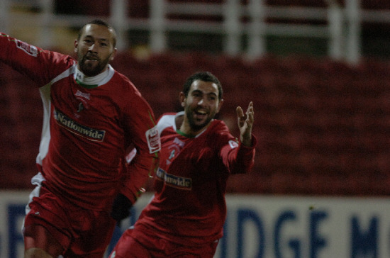GOAL-DEN BOY Christian Roberts celebrates with Sofiane Zaaboub during Town's 2-1 win over Bury at the County Ground on Saturday