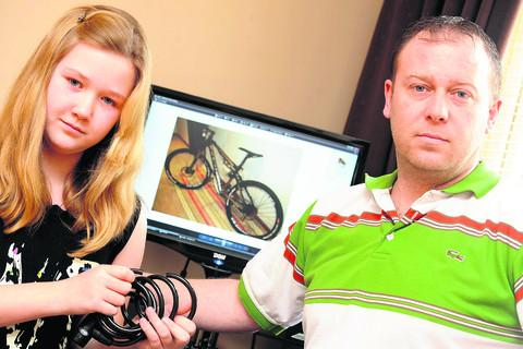 11-year-old Emily Usher and her dad Paul whose bicycles were stolen from outside McDonalds in Wharf Green