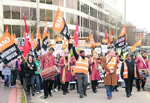 Members of the GMB marching through town to show support to employees contracted to work at the Great Western Hospital
