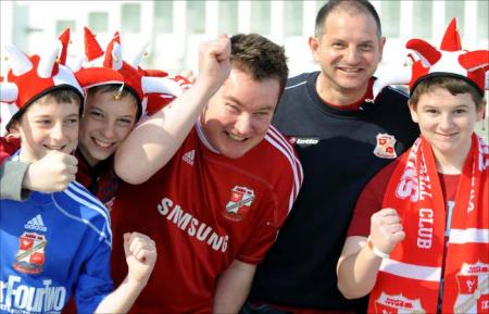 Thousands of fans in the Red and White Army of Swindon Town flock to Wembley to cheer on The Robins against Chesterfield