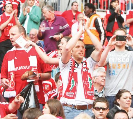 Thousands of fans in the Red and White Army flock to Wembley to cheer on Swindon Town against Chesterfield