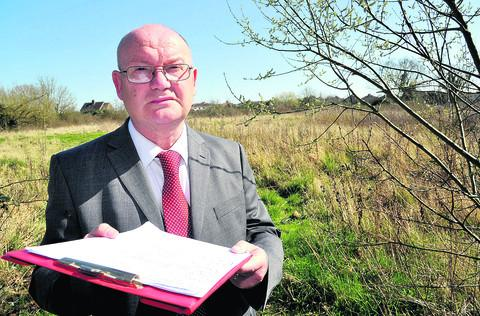 Coun Jim Grant at Pickard's Small Field with the petition for the protection of green spaces