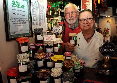 Bob and Penny Warren with a selection of jams on sale for charity at The Trout Inn at Lechlade