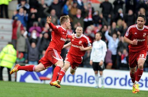 Swindon's Matt Ritchie celebrates his goal