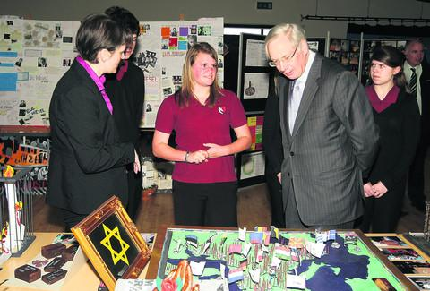 The Duke of Gloucester looking around the Speak Up, Speak Out exhibition during his visit to Royal Wootton Bassett School