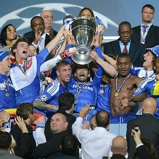 Chelsea players celebrate as they lift the UEFA Champions League trophy at the Allianz Arena, Munich, Germany
