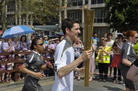 Thousands bask in the sun enjoying the spectacle of the Olympic Torch