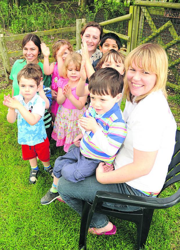 From rear left, Karen Doyle, Rosaleen Monk and Jenni Saunders with some of the children