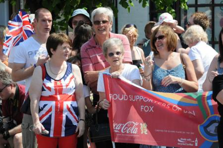 Having fun in the sun as the torch bearers race through Wootton Bassett