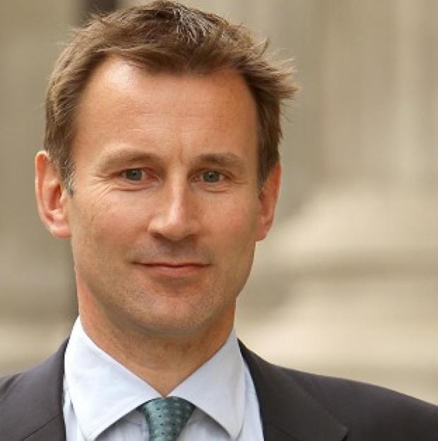 Culture Secretary Jeremy Hunt has been backed by PM David Cameron after giving evidence to the Leveson Inquiry