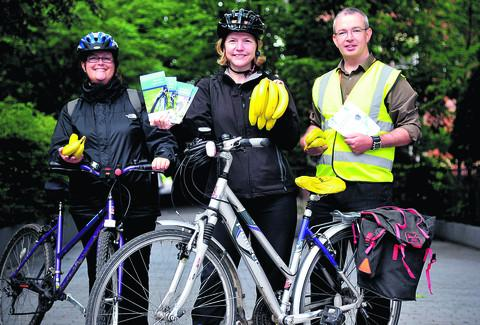 Hannah Matthews, Claire Fleming and Keith Smith launched Swindon Cycle Challenge by handing out bananas on the cycle path on Farnsby Street