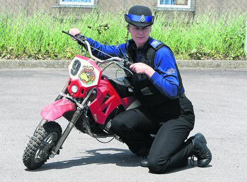PCSO Juliet Evans with a seized mini-moto in Highworth