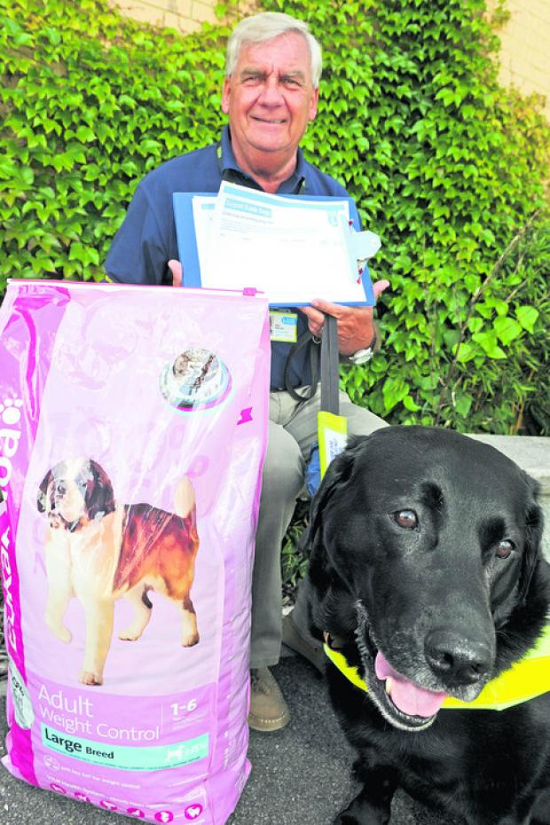 Swindon Guide Dog branch chairman Alan Fletcher with his Labrador Joy