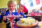 Damien Miles and Ben Stratford enjoy an Olympic breakfast at Westrop Primary