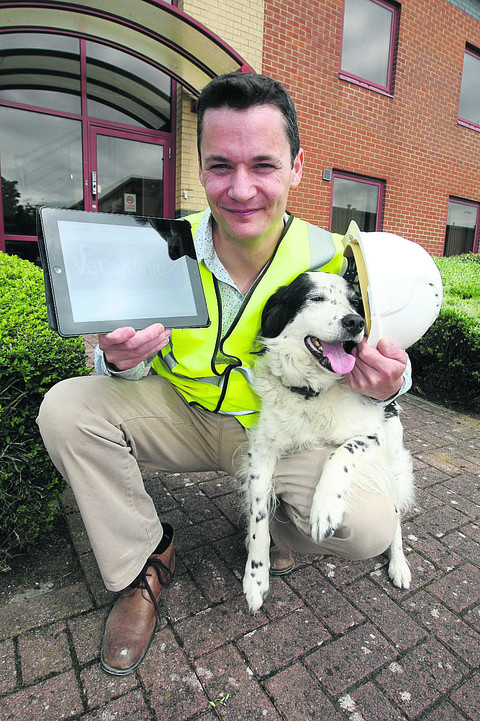 Joe Inglis with his dog, Jack, at the vets in Bridgemead