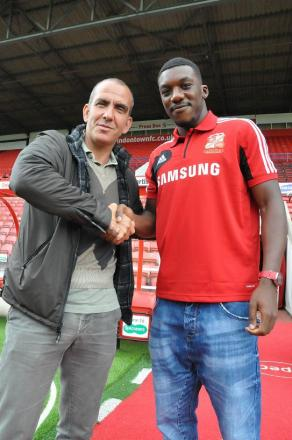 Swindon Town's Troy Archibald-Henville with boss Paolo Di canio