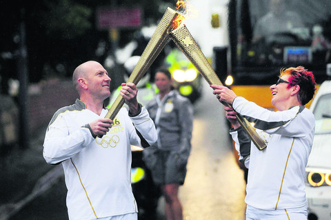 Paul Clark  and Jo Shorey carry the torch in Weymouth