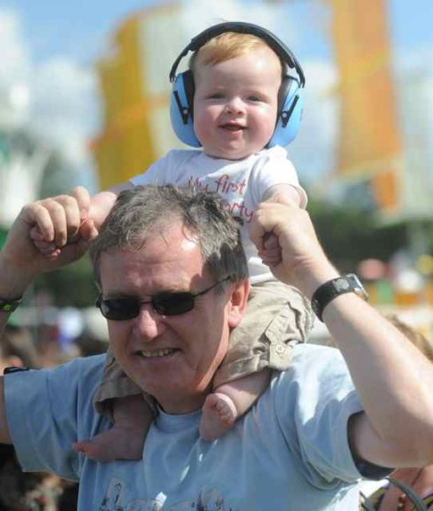 Elliot and dad Paul Tuckett, of Corsham, enjoy the sounds in safety at WOMAD
