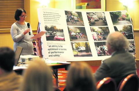 Kareen Boyd speaks to residents at a public meeting against the building of Croft School
