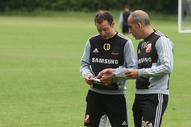Paolo Di Canio (left) and Claudio Donatelli talk tactics
