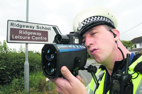 PC Phil Matthews using a speed camera on Swindon Road, Wroughton, where a motorist was caught speeding at 89mph in a 30mph zone