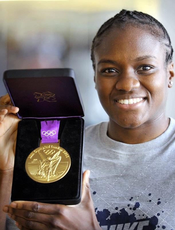 Nicolas Adams shows of her medal