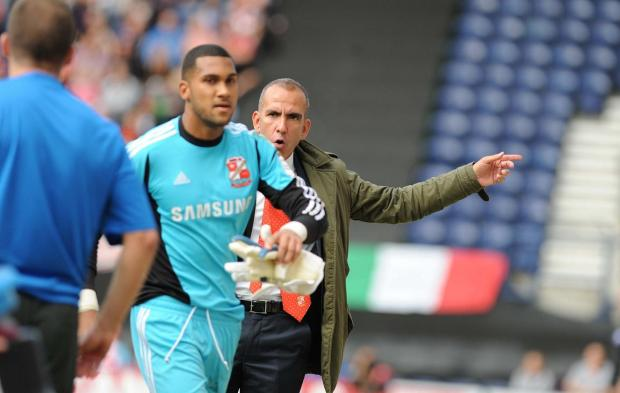 Swindon Advertiser: Paolo Di Canio clashes with Wes Foderingham at Deepdale after substituting his goalkeeper after just 22 minutes.