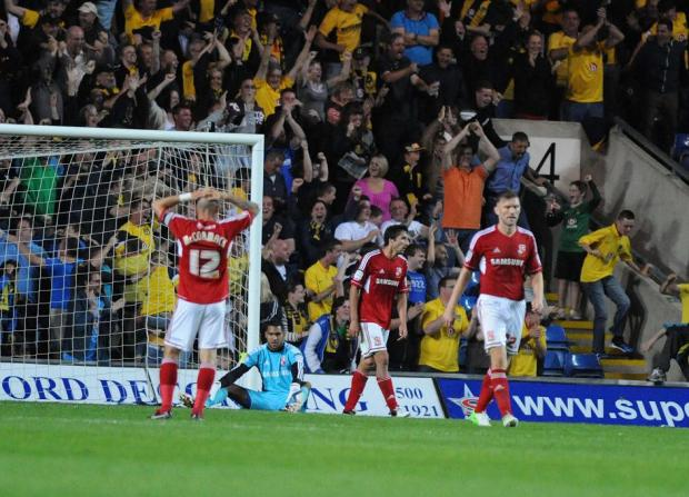 LATE BLOW: Wes Foderingham is left floored by Oxford's winner