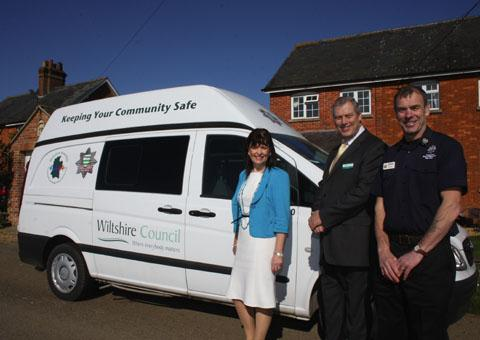 Maggie Rae, John Thomson and John Popowicz with one of the vans