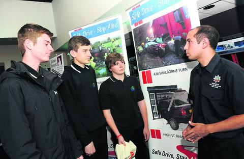 Bradon Forest School students Callum Gumston, Rob Mills and Oliver Smith talk to firefighter Chris Davis