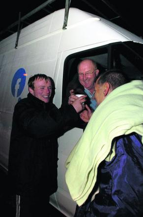 Chairman Angus Macpherson helping out to deliver hot drinks and food to two homeless men