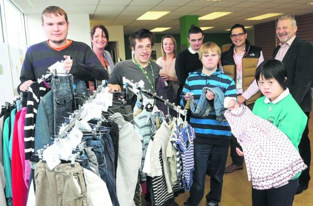 Suits you At The Shop at Uplands are pupil Lewis Dinsey, staff member Emma Young, pupil Ricky Fitchett, staff member Lorna Braid, pupils David Smith and Mark Rowlands, staff member David Stevens, pupil Nicole Tiet and deputy head Andy Segal