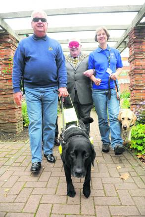 Guide Dogs volunteer Alan Fletcher with Joy, mayor Mick Bray and Philippa Davidson with Rusty