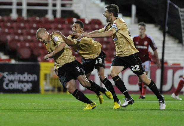 Swindon Advertiser: Ex-Town full-back Michael Rose celebrates his winner last night
