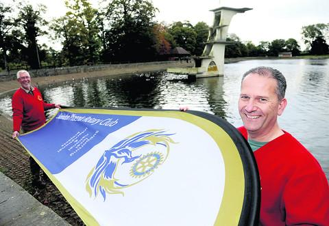 Dragon boat committee member Michael Slipper and Rotary Club of Swindon Phoenix president Paul Parfrey