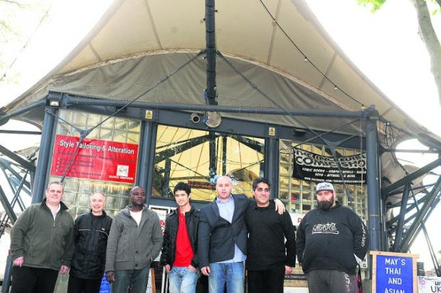 Going strong Traders at the tented market three years after reopening. From left, are Karl Edwards (Computer Wizard), Steve Hollister (The Little Rock Shop), Kofi Acheampong (Komo Afro mini mart), Reza Alavi (Style Tailoring and Alteration), Jerry Tortori