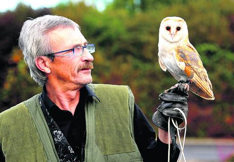 Colin Sutherland with Rocky the Barn Owl